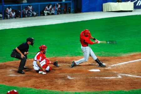 the national team: Image of the game betwen Canada and Cuba in the baseball worldcup. .Cuba was the winner,5x1,and pass to the final with USA.