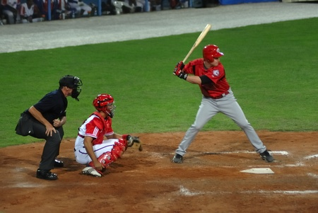 touch base: Image of the game betwen Canada and Cuba in the baseball worldcup. .Cuba was the winner,5x1,and pass to the final with USA.