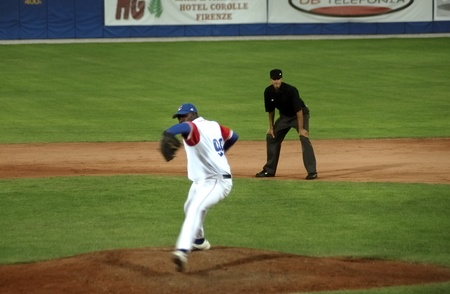 homeplate: Image of the game betwen Canada and Cuba in the baseball worldcup. .Cuba was the winner,5x1,and pass to the final with USA.