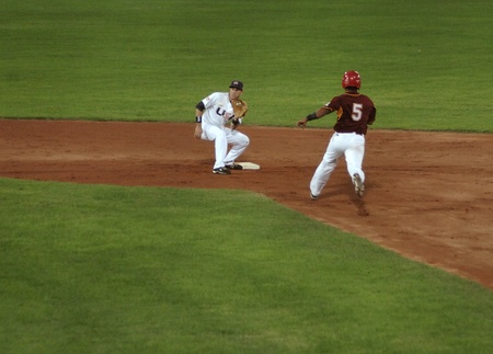bases: Image of the game betwen USA and Venezuela in the baseball worldcup 2009, in florence, italy.The team of USA was the winner of the game,6x3.  Editorial
