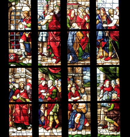 Ancient stained glass in the cathedral of Milan, Italy photo