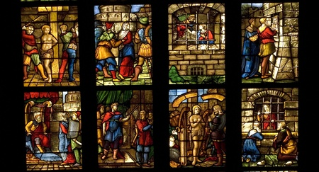 christian community: Ancient stained glass in the cathedral of Milan, Italy