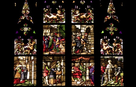 catholic stained glass: Ancient stained glass in the cathedral of Milan, Italy