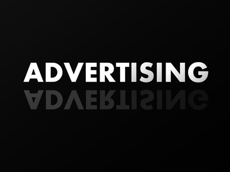 mirror reflection: The word ADVERTISING in mirror reflection on black background.