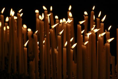 hymnal: Candles in church
