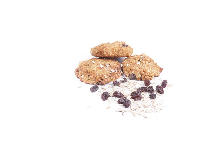 Oatmeal cookies with raisin on isolated background photo