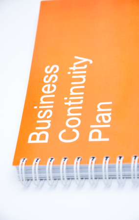 Small notebook with inscription Business continuity plan Stock Photo