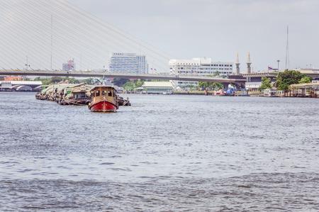 Trade boats navigating the river in Bangkok