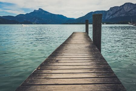 Wooden pier on Mondsee lake Stock fotó