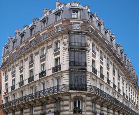 blue facades sky: Architecture : typical Parisian building in corner of Hector Malot Street and Daumesnil Avenue. Panoramic assemblage.