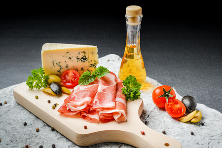 rakia: Cold appetizer. Prosciutto ham, salami and blue cheese with vegetables, olives and rakia
