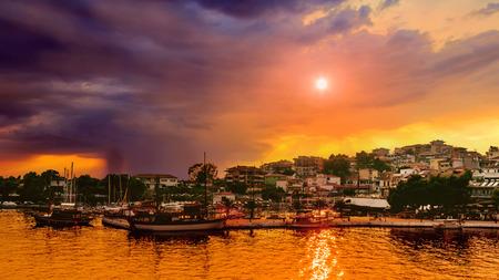 upcoming: Dramatic sunset and upcoming rainy storm at the Neos Marmaras, Halikidiki, Sithonia, Greece.