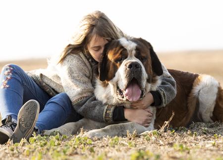 Girl and her big Bernard dog Stock Photo