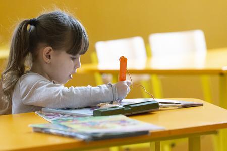 Beautiful little girl having fun at school