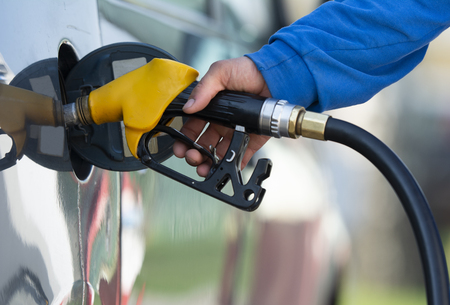 To fill the machine with fuel.   Gas station pump. Man filling gasoline fuel in car holding nozzle Reklamní fotografie