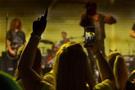 Video recording of the concert on the smartphone Stok Fotoğraf - 132135131