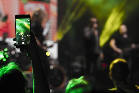 Video recording of the concert on the smartphone Stok Fotoğraf - 132135349