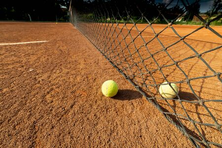 Tennis game background. Training tennis ball on the tennis court Stock Photo - 135476989