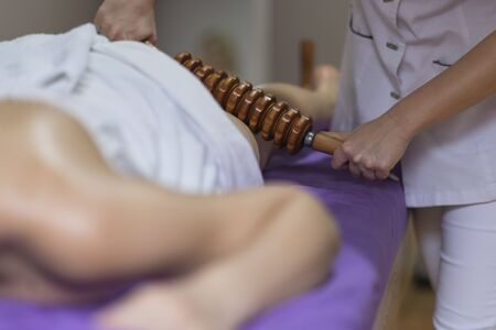 Woman getting Thai massage from professional masseuse Stockfoto