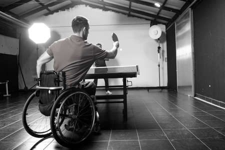 Wheelchair user with a tennis racket in their hands. Rehabilitation of the disabled. Sport and a healthy lifestyle.