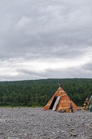 Wigwam of birch bark on the island. Bahta river, Siberia