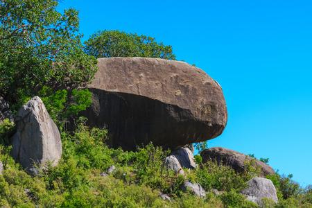 Big stone among savanna. Beautiful landscapes of Serengeti, Tanzania 版權商用圖片