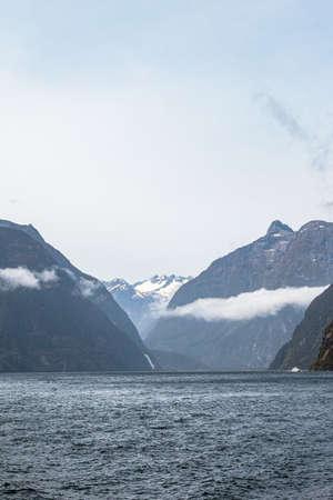 Majestic peaks among the sea. FiordLand National Park. South Island, New Zealand Stok Fotoğraf