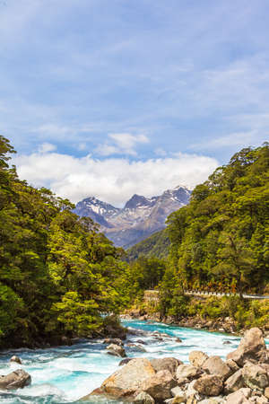 Landscape with a turbulent river near Pop's View lookout. Fiordland national park. South Island, New Zealand