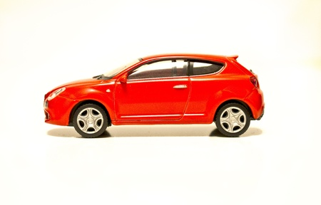 Model car red metallic side view on white isolated background