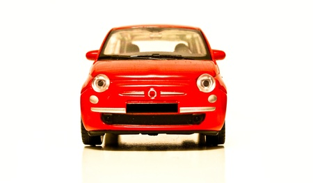 Red toy car on white isolated background photo
