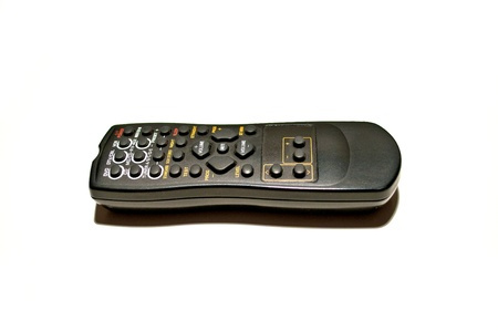 Black remote on white background photo