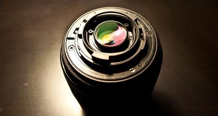 Photo lens on black table