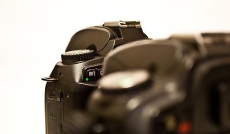 Photo cameras on white background photo