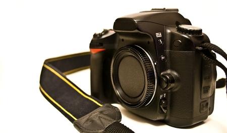 Photo camera on white background photo