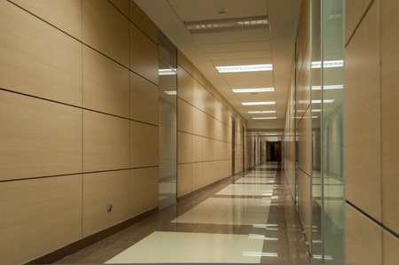 vanish: Long beige corridor in a modern office building