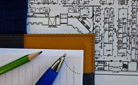 organizer, pen, pencil and drawing on the table Stock Photo - 8764771