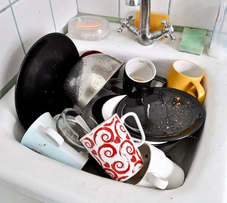 messy kitchen: the dirty dishes in the sink