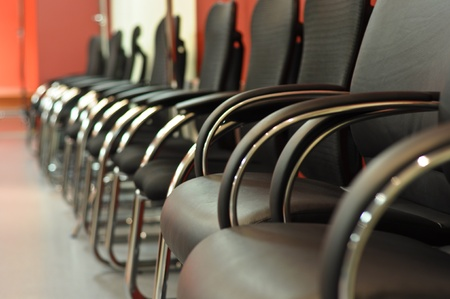 elbow chair: black leather office chair close-up Stock Photo