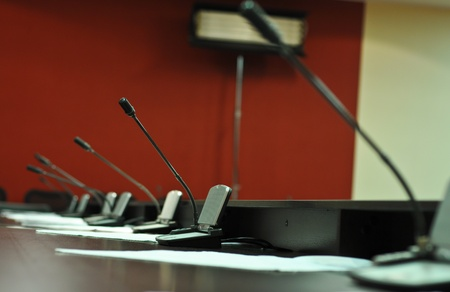 Conference table, microphones close-up photo