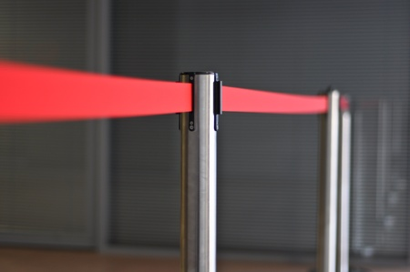 restrictive red tape on metal racks photo