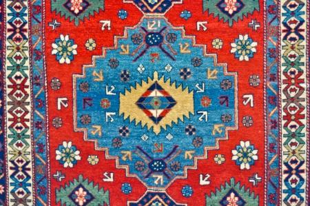 rug: colored wool handmade carpet closeup
