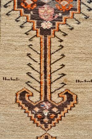 colored wool handmade carpet closeup photo