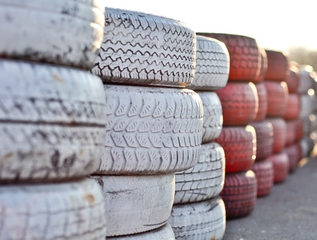 racetrack fence of white and red of old tires photo