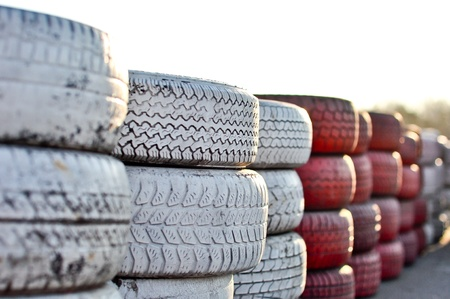 racetrack fence of white and red of old tires Stock Photo - 9439581