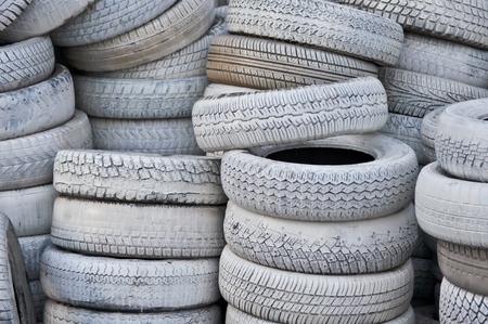 the white automobile tires dumped in a a big pile photo
