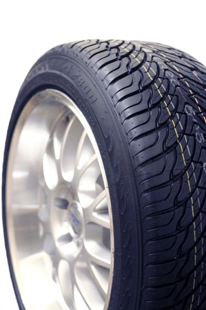 Low-profile car wheel on a white background