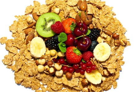 a lot of different fruits and nuts and corn flakes photo