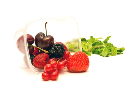 berries in a plastic box on a white background photo