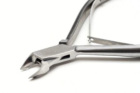 nail forceps isolated on white background photo