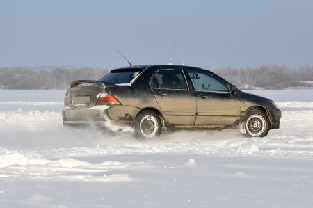 cornering: Car cornering spray snow Stock Photo